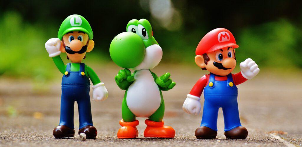 3 Playmobilfiguren als Sinnbild für Gespräch im Coaching